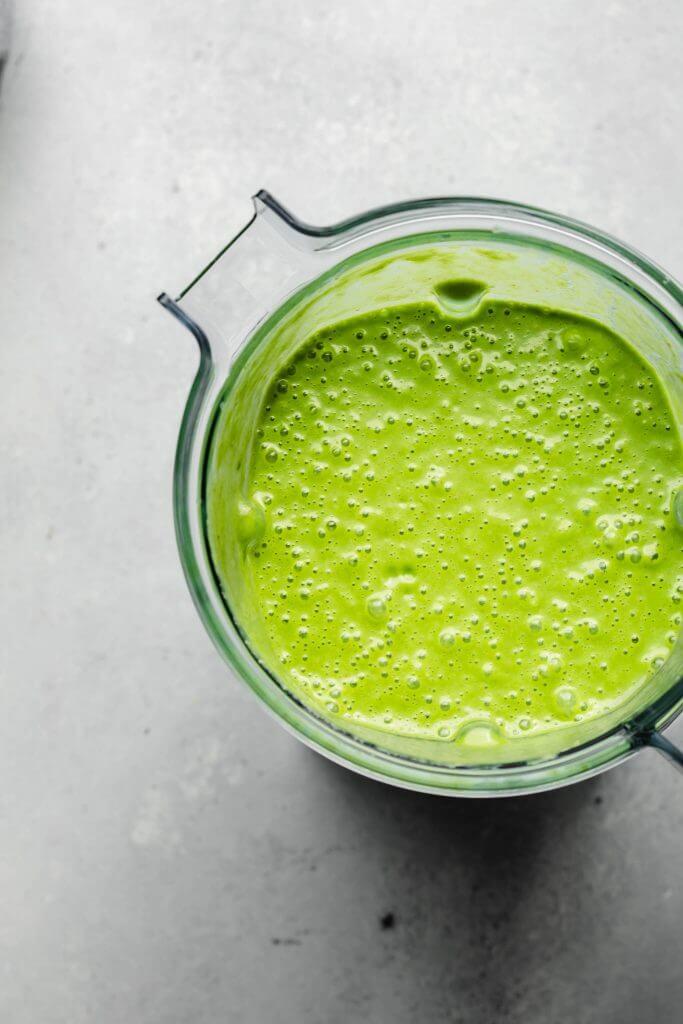 Green goddess smoothie in blender.