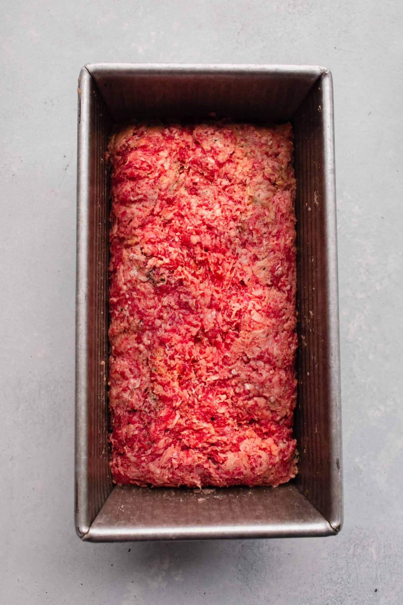 Unbaked meatloaf in pan.