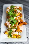 Roasted Squash with Yogurt Cilantro Sauce platingsandpairings.com