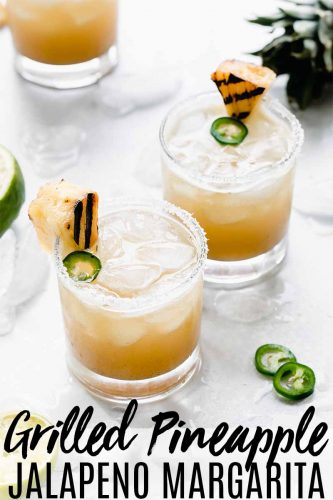 This Grilled Pineapple Margarita is the perfect blend of sweet, spicy & smoky. Caramelized pineapple, spicy jalapeno & a splash of vanilla make it delicious. #margarita #pineapplemargarita #cocktailrecipe #cincodemayo