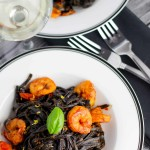 Squid Ink Pasta with Shrimp + Cherry Tomatoes platingsandpairings.com