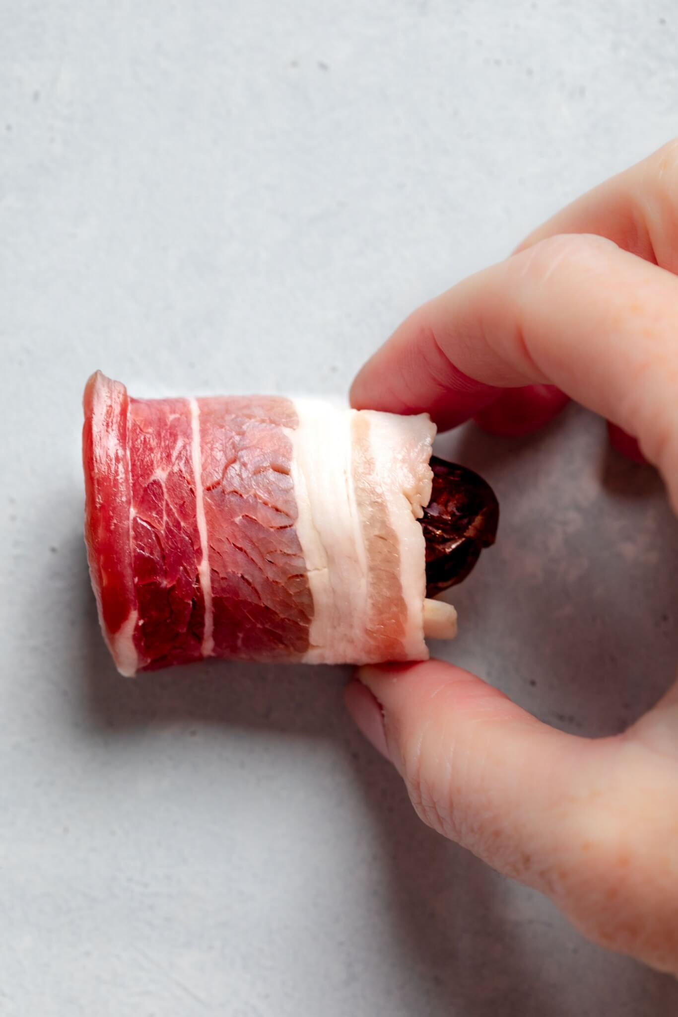 Date wrapped in bacon before baking