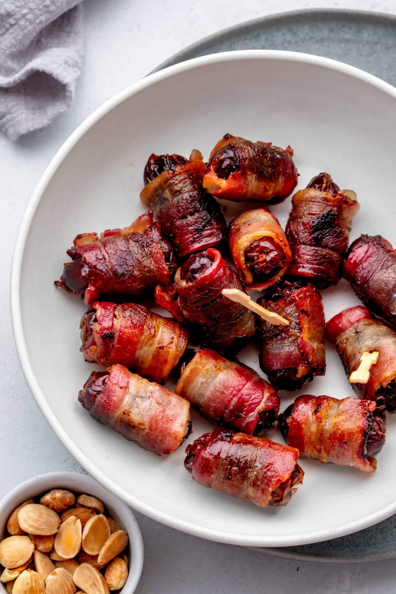 Overhead shot of bacon wrapped dates in bowl.