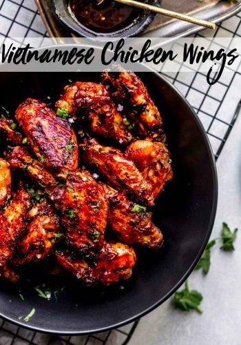 These Vietnamese Chicken Wings are baked in the oven until crisp & coated in a sweet-spicy combination of sweet soy sauce and sambal oelek chili paste.