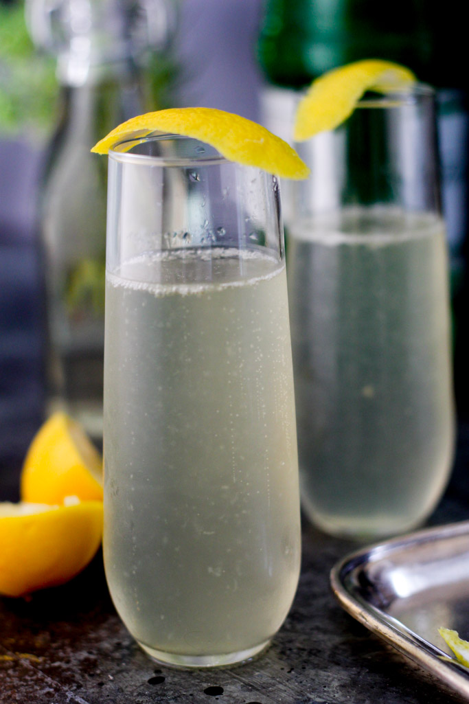 The French 75 Champagne Cocktail - Everyone needs a go-to elegant party cocktail in their arsenal - This is mine! | platingsandpairings.com