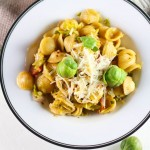 Orecchiette with Brussels Sprouts and Bacon - A quick, delicious 30 minute weeknight meal | platingsandpairings.com
