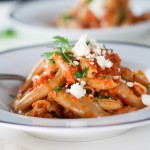 This Pasta with Chipotle Cream Sauce will change up your basic pasta routine. Smoky chipotle peppers lend a bit of heat while the cotija cheese makes it incredibly creamy and delicious. It's a perfect #MeatlessMonday option! | platingsandpairings.com