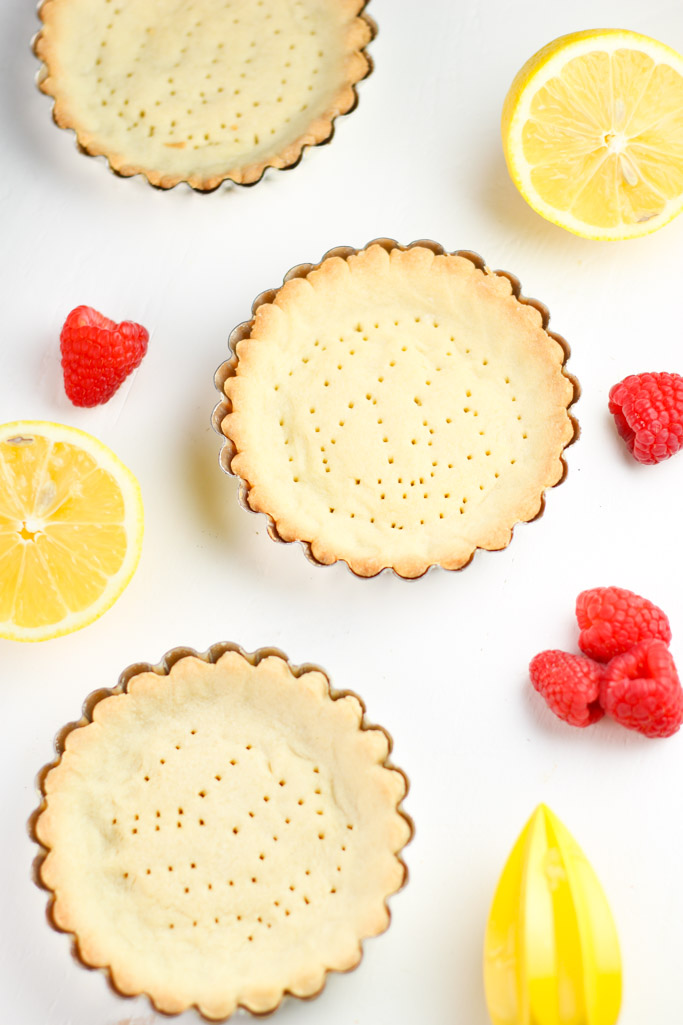 These Lemon Raspberry Tartlets are the perfect balance of tangy and sweet, with a delicate buttery crust | platingsandpairings.com