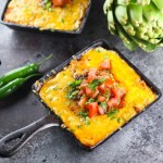 Shake things up at your next get together with this cheesy Artichoke Queso Fundido. Serrano peppers and chorizo give it a spicy kick, while the artichoke hearts are the perfect unexpected addition, in this melty, ooey-gooey cheese dip   platingsandpairings.com