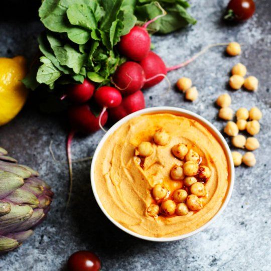 This Harissa Hummus is smoky, spicy and tangy. A perfect party dip! | platingsandpairings.com