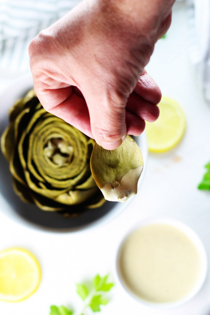 This artichoke dipping sauce is my favorite! It turns even the pickiest eater into a steamed artichoke lover and is made with ingredients that you probably already have on hand - Like magic! | platingsandpairings.com