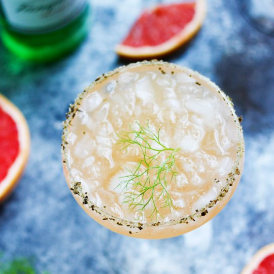 Fresh Grapefruit Juice and a Fennel Simple Syrup combine with a Rosemary Salted Rim in this Salty Dog Variation   platingsandpairings.com