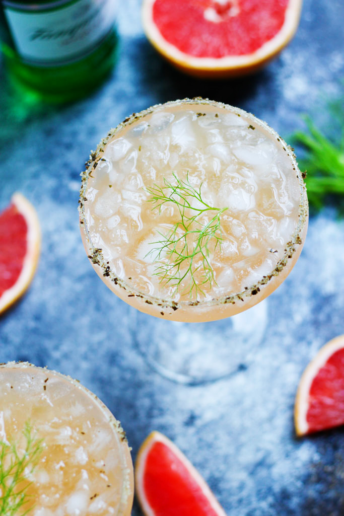 Fresh Grapefruit Juice and a Fennel Simple Syrup combine with a Rosemary Salted Rim in this Salty Dog Variation | platingsandpairings.com