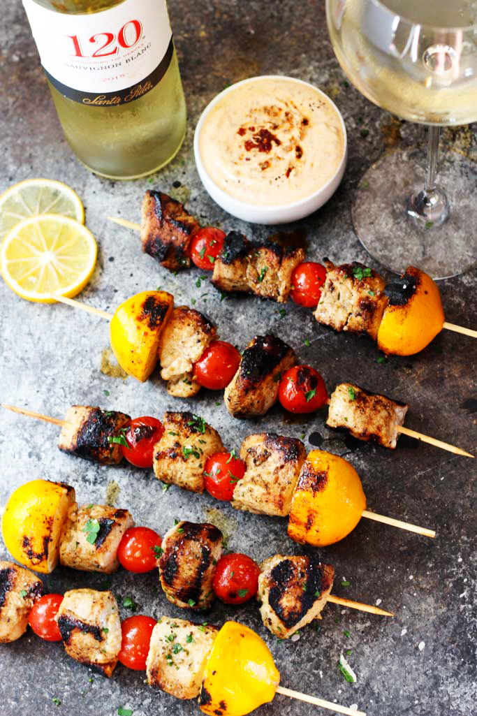 Say bye-bye to boring grilling this summer! These Lemon Chicken Skewers cook up perfectly on the grill and are served with a side of Harissa Yogurt Sauce for extra flavor | platingsandpairings.com