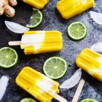 These Mango Lassi Popsicles are the perfect treat for a warm summer day. Creamy mango and vanilla yogurt combine with tangy lime, and spices of ginger and cardamom | platingsandpairings.com