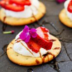 These Strawberry Bites with Goat Cheese Mousse and Balsamic Glaze are easy to make at home, with simple ingredients, and make a perfect party appetizer | platingsandpairings.com