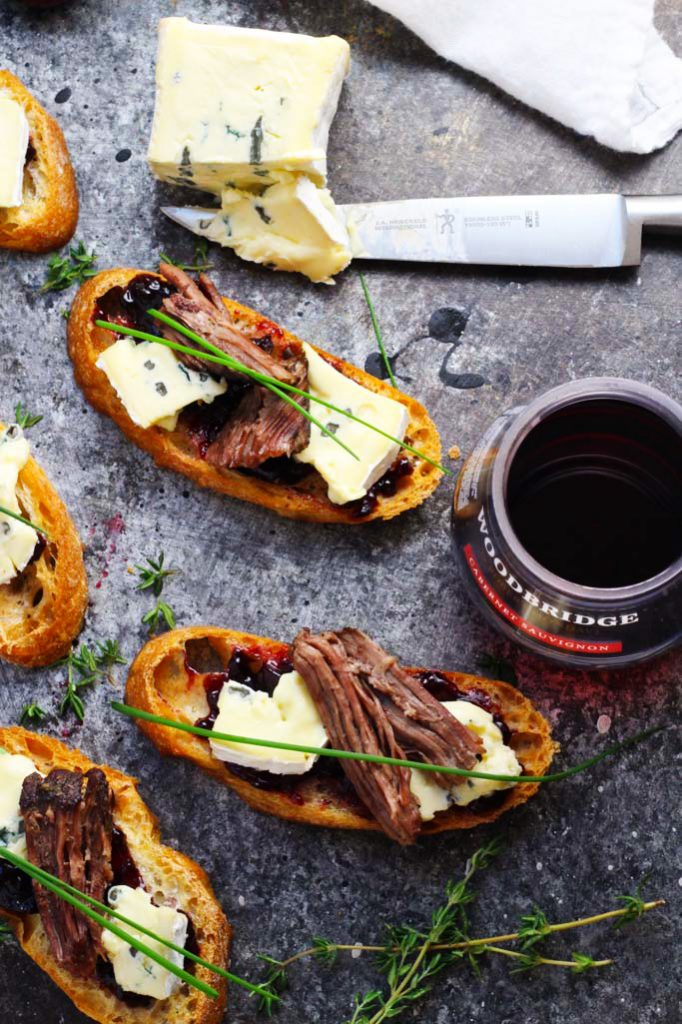 These Short Rib Crostini with Cambozola Cheese and Cherry Jam make a perfect appetizer that's as suitable for elegant entertaining as it is for football tailgating | platingsandpairings.com