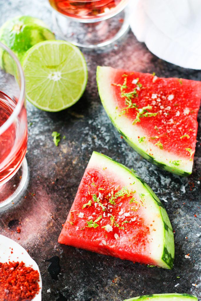 Sprinkle watermelon with Aleppo chili pepper, lime zest, and salt for an icy-cold sweet and spicy treat that's perfect for summer | platingsandpairings.com