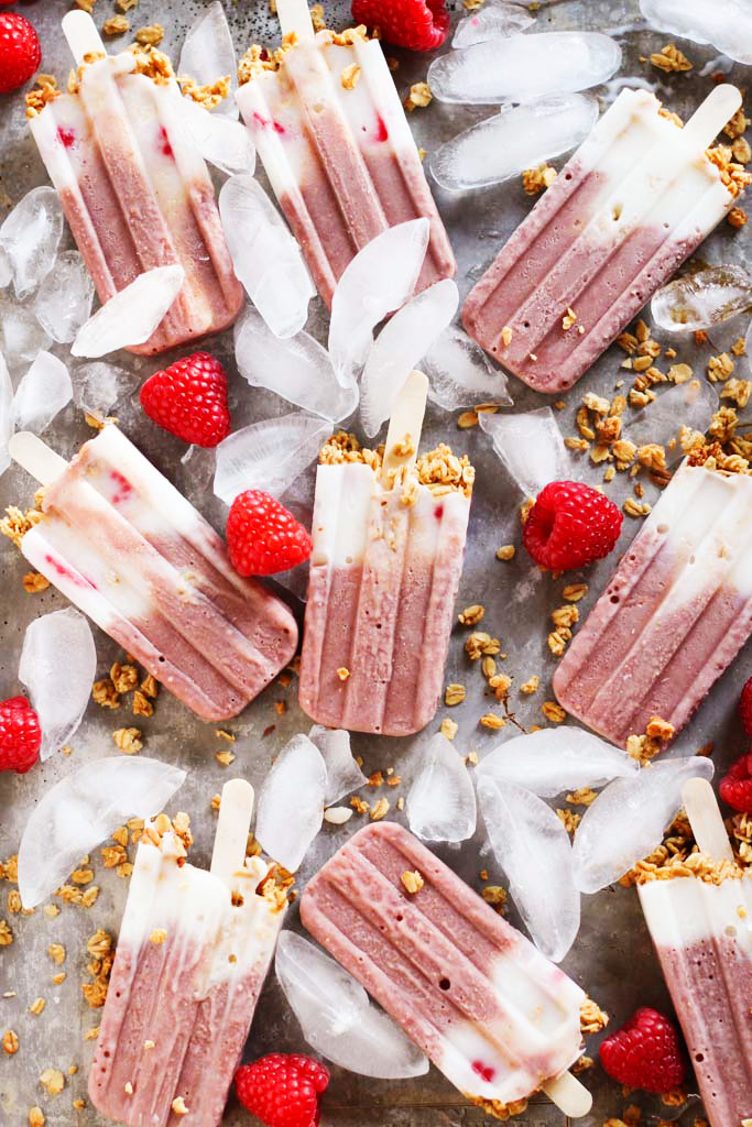 These Yogurt & Granola Breakfast Protein Popsicles prove that you can have dessert for breakfast! Made with raspberries, dairy-free yogurt, and hearty granola - It's a healthy vegan treat that will keep you energized throughout the morning. | platingsandpairings.com