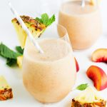 This Pineapple Peach Mint Smoothie is a refreshing way to start your day! Pineapple, peach and pear combine with fresh mint in this tasty treat. The addition of acai berry powder and pumpkin seeds gives a nutritional boost. | platingsandpairings.com