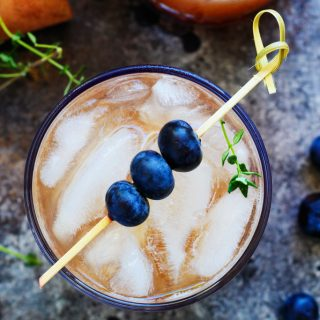 This Blueberry Bourbon Smash Cocktail combines fresh blueberries, apple cider, vanilla and bourbon for a comforting cocktail that's perfect for the Fall season. | platingsandpairings.com