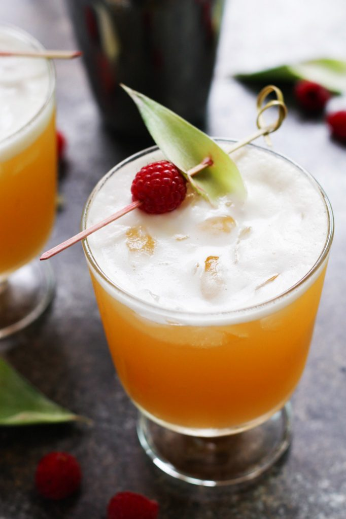 This Pineapple Raspberry Vanilla Vodka Collins is a refreshing, tropical cocktail that's as delicious as it is beautiful. | platingsandpairings.com