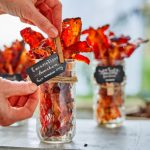 Learn how to create a DIY Bacon Bar - It's the perfect DIY solution for entertaining a crowd at breakfast or brunch! We're taking bacon to the extreme with a variety of flavored bacons, bacon biscuits, bacon flavored salt and even bacon jam. | platingsandpairings.com