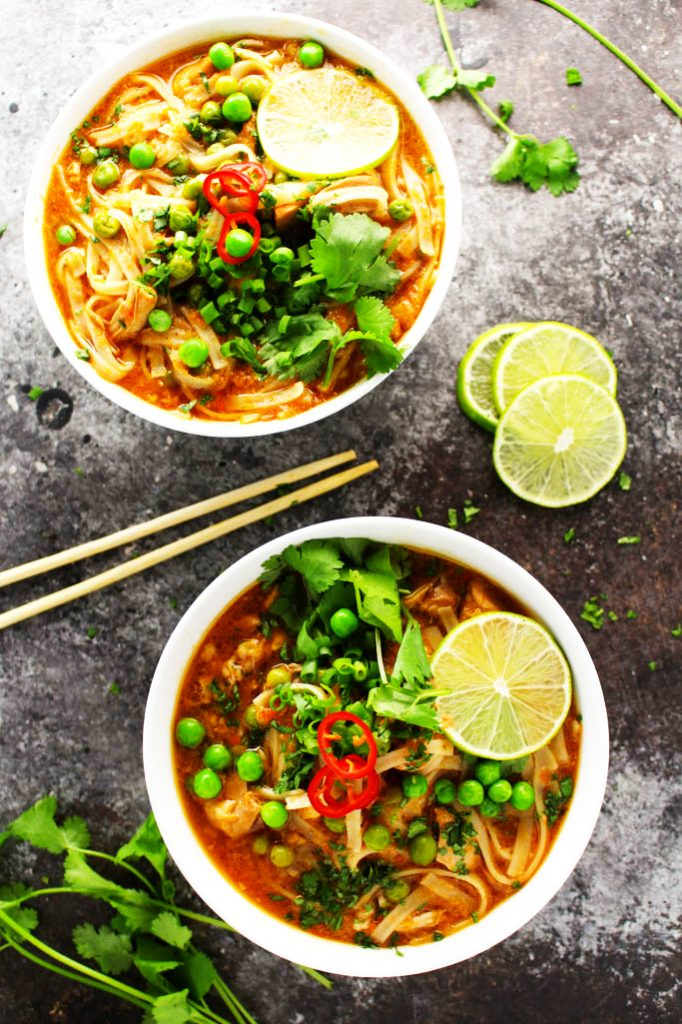 This Easy Slow Cooker Thai Chicken Noodle Soup makes it easy to enjoy your favorite spicy, aromatic, authentic Thai soup at home! | platingsandpairings.com