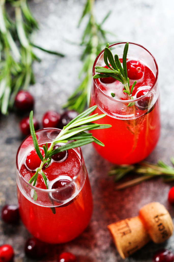 This Cranberry Ginger Bellini is a festive sparkling cocktail that's perfect for brunch or holiday parties. | platingsandpairings.com