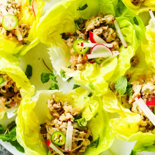 These Larb Gai Thai Lettuce Wraps will have you hooked on their spicy, zesty flavor. Ground chicken combines with plenty of fresh mint, lime juice and lemongrass for a healthy Thai dish that's perfect for lunch or dinner. | platingsandpairings.com
