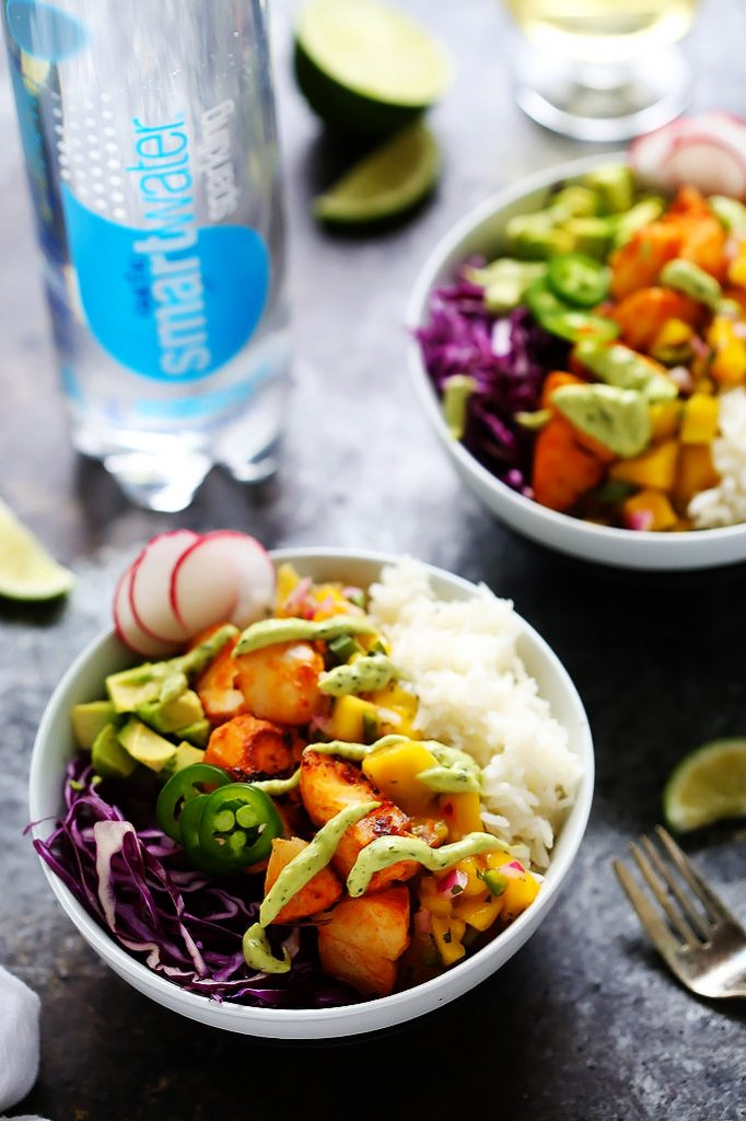 These Fish Taco Bowls with Mango Salsa & Avocado Cream Sauce make a quick and healthy weeknight dinner that's ready in under 30-minutes! | platingsandpairings.com
