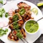 Grilled Pork Medallions with Mojo Sauce is a quick & easy weeknight dinner idea. Tender pork pieces are quick grilled & topped with a spicy Cuban mojo sauce. | platingsandpairings.com
