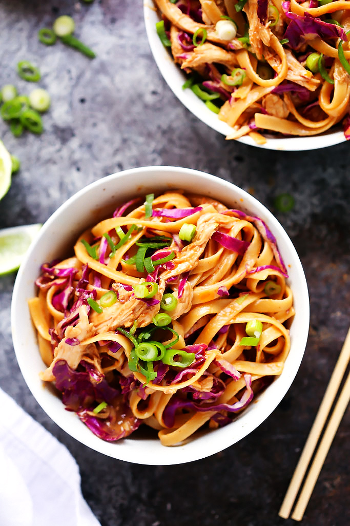 These 20-Minute Sesame Chicken Noodle Bowls with Thai-style creamy peanut sauce and crunchy red cabbage make a perfect quick and easy weeknight dinner. | platingsandpairings.com