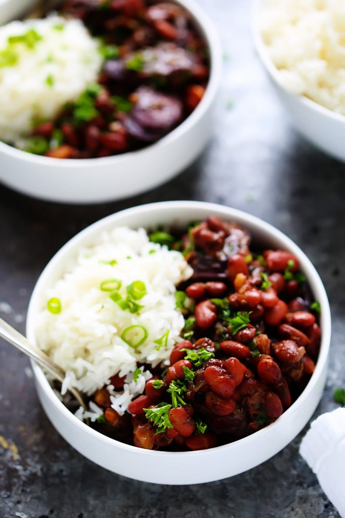 Instant Pot Red Beans & Rice is a traditional New Orleans recipe made with smoked sausage, red beans and cajun seasoning. Plus, with the help of your pressure cooker there's no soaking the beans, meaning that this delicious dinner can be on your table in under an hour! | platingsandpairings.com