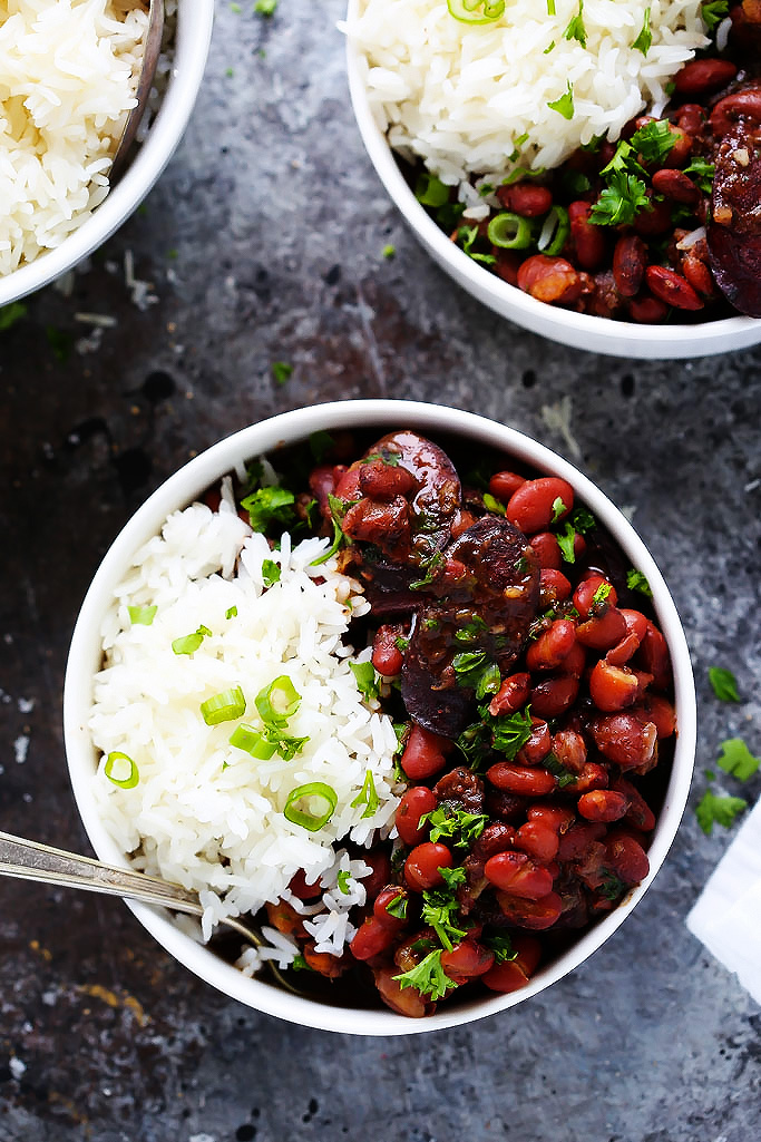 Instant Pot Red Beans & Rice is a traditional New Orleans recipe made with smoked sausage, red beans and cajun seasoning. Plus, with the help of your pressure cooker there's no soaking the beans, meaning that this delicious dinner can be on your table in under an hour!   platingsandpairings.com