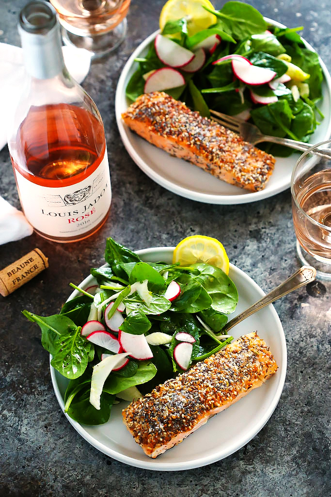 "This ""Everything"" Crusted Salmon coats salmon filets in a seasoning combined of all the ingredients you would find on an ""everything"" bagel. The salmon filets are quick seared and then finished off in the oven for a delicious dinner that's ready in 20 minutes. 