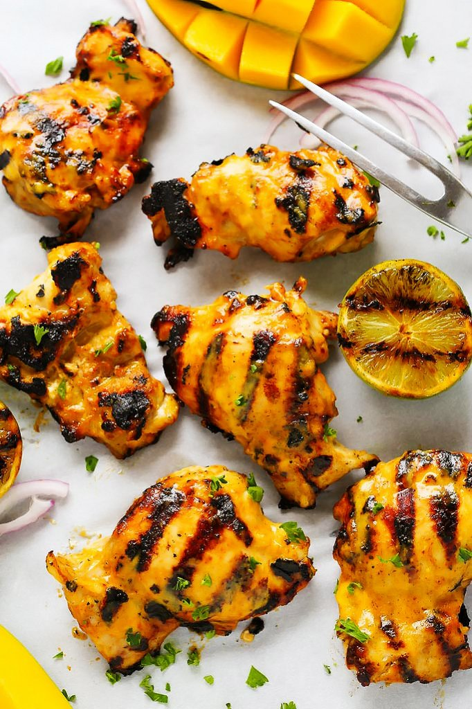Mango Lime Grilled Chicken features a sweet and spicy mango lime marinade that caramelizes perfectly on a hot grill. It's perfect for your summer BBQ.   platingsandpairings.com