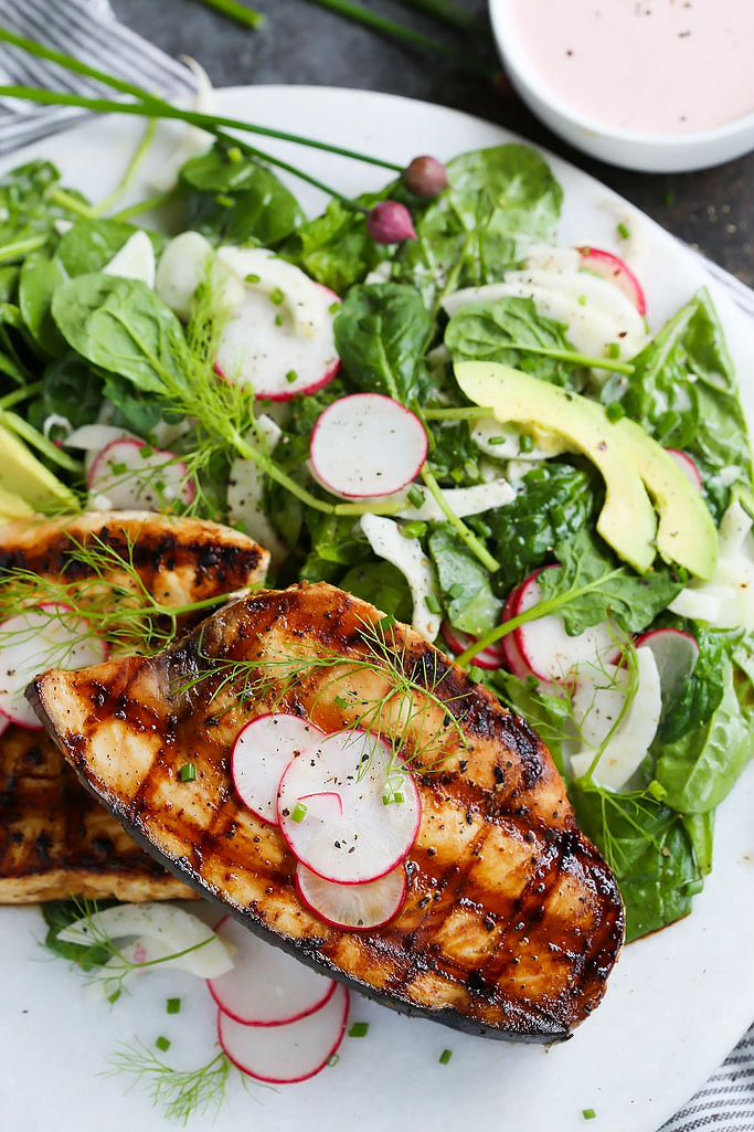 Grilled Swordfish with Tangy Rosé Wine Mayonnaise will take your grilling to the next level. Grilled swordfish is topped with rosé wine mayonnaise that is also turned into a creamy vinaigrette used to dress a simple & refreshing salad of fennel, radish and avocado. | platingsandpairings.com