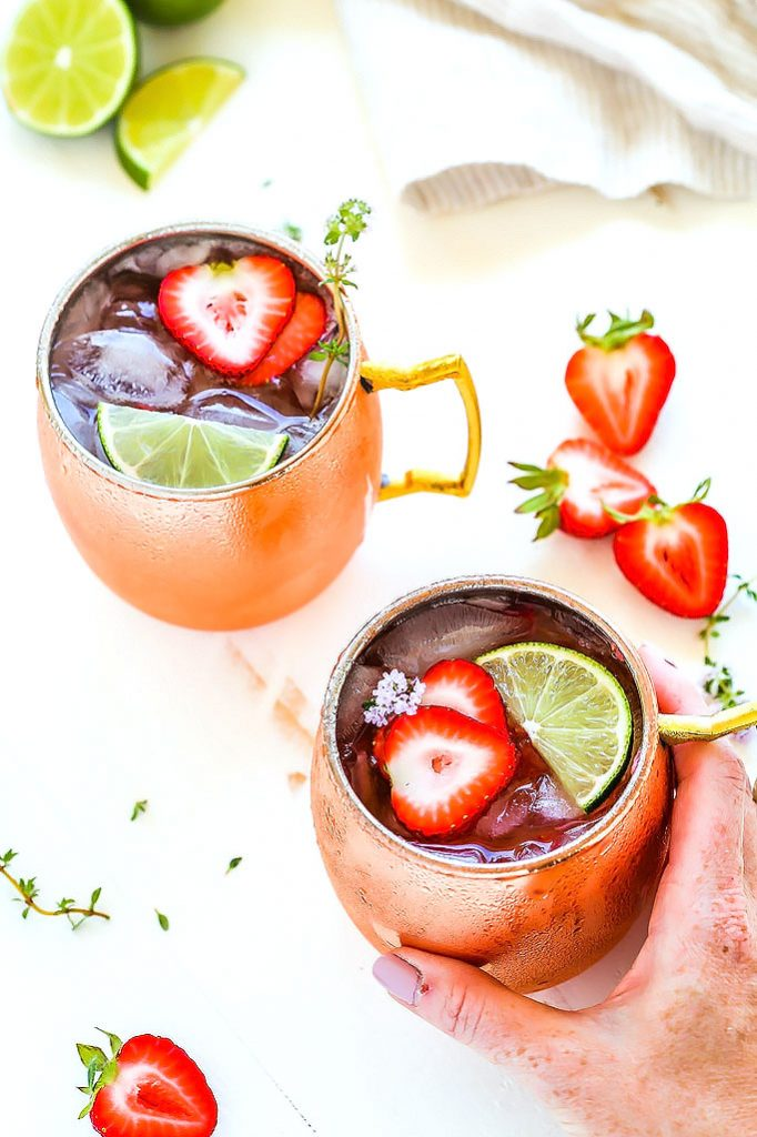 Try this Strawberry Lime Moscow Mule for a twist on the traditional Moscow Mule cocktail. Fresh strawberries, lime juice, vodka and ginger beer combine together in this delicious and refreshing icy cocktail.   platingsandpairings.com
