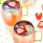 Try this Strawberry Moscow Mule for a twist on the traditional Moscow Mule cocktail. Fresh strawberries, lime juice, vodka and ginger beer combine together in this delicious and refreshing icy cocktail. | platingsandpairings.com