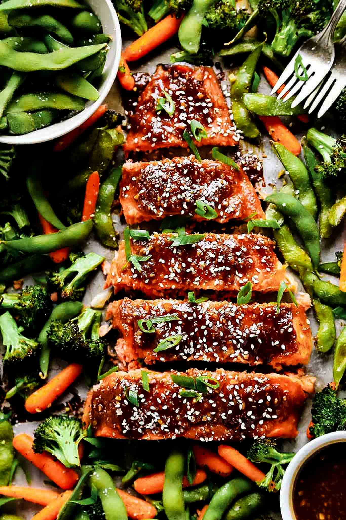 Overhead shot of miso salmon on sheet pan with veggies.