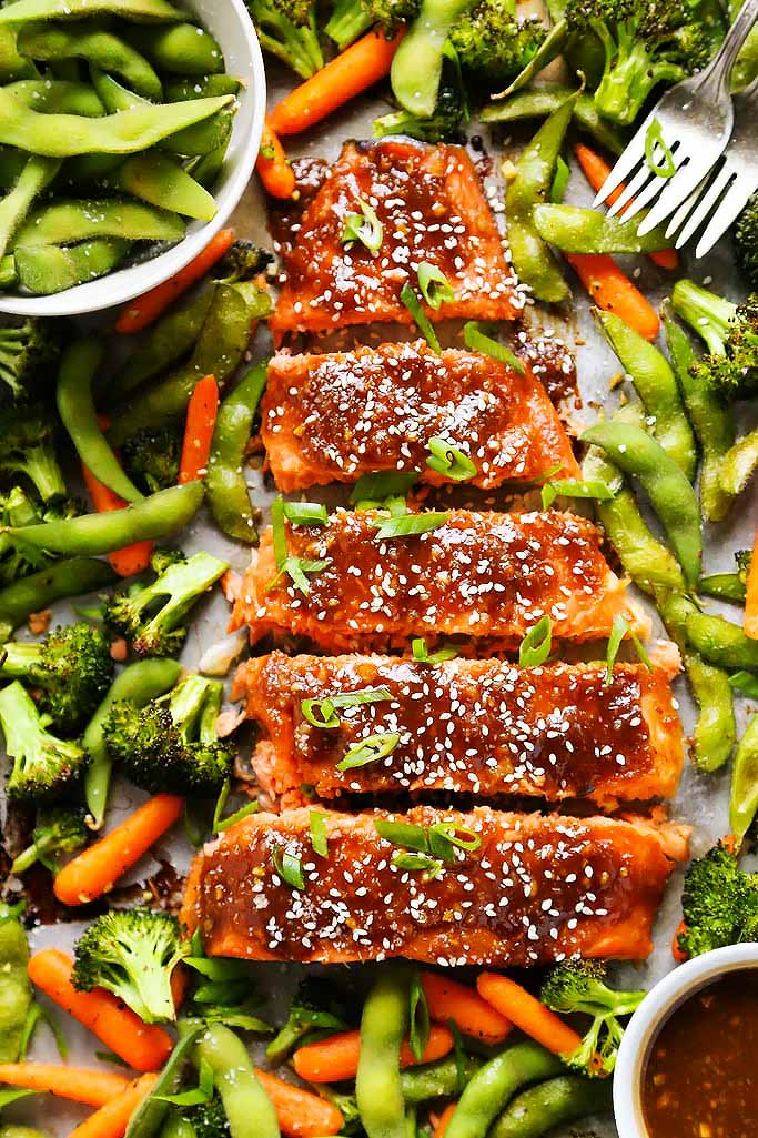 One Pan Miso Glazed Salmon and Vegetables is an easy meal perfect for busy weeknights. Best of all, it's baked on ONE sheet pan with flaky salmon, crispy veggies, edamame and a flavorful miso glaze. | platingsandpairings.com