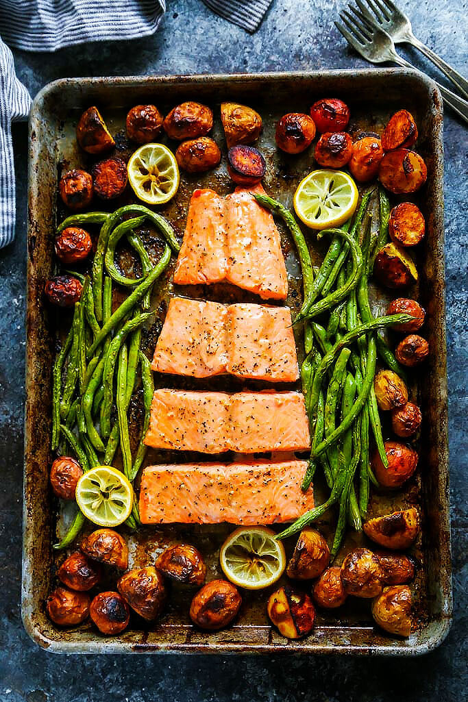 This 5 Ingredient Sheet Pan Salmon is the perfect dinner for busy weeknights! This complete seafood dinner cooks in just 30 minutes and the cleanup is easy too! | platingsandpairings.com