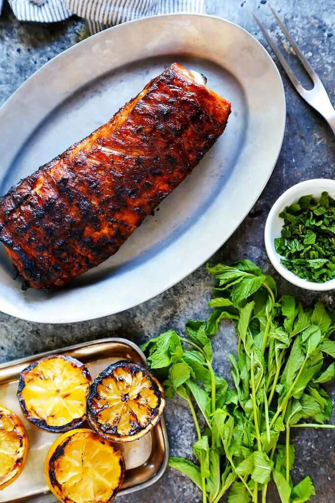 This Grilled Pork Tenderloin with Charred Lemon Chimichurri is the perfect quick dinner for hot summer nights! You can grill this beautiful dinner and prepare the amazing sauce in just 30 minutes. | platingsandpairings.com