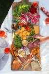 It's easy to host a Rosé wine party at home with these simple tips. Learn how to create a gorgeous charcuterie board with homemade rosé wine mustard that also doubles as a parting gift for your guests!   platingsandpairings.com