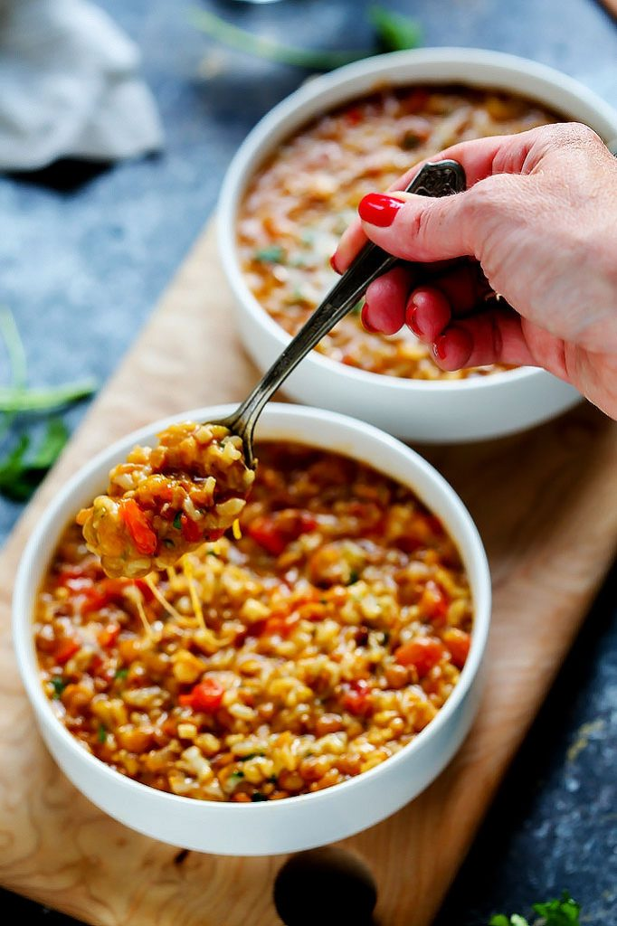 This Instant Pot recipe for Cheesy Southwestern Lentils & Brown Rice is the perfect quick vegetarian weeknight dinner recipe that's perfect for Meatless Monday! Hearty lentils and brown rice combine with southwestern spices, tomatoes, peppers & plenty of melty cheese!   platingsandpairings.com