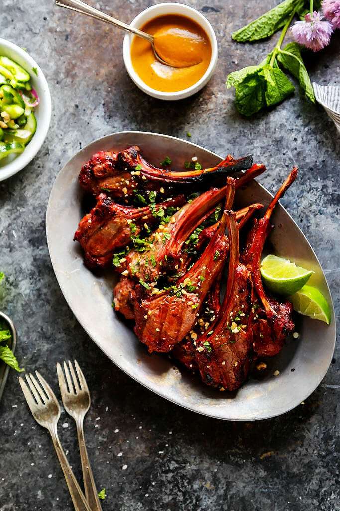 These Lamb Chops with Spicy Peanut Sauce are perfect for your next BBQ. Rich, smoky grilled lamb pairs perfectly with the creamy, tangy Thai-style spicy peanut sauce. It's a delicious, quick and easy dinner. | platingsandpairings.com