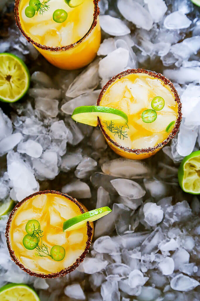 This Mango Michelada is a Mexican beer cocktail that's sweet and spicy and perfect for summer sipping! | platingsandpairings.com