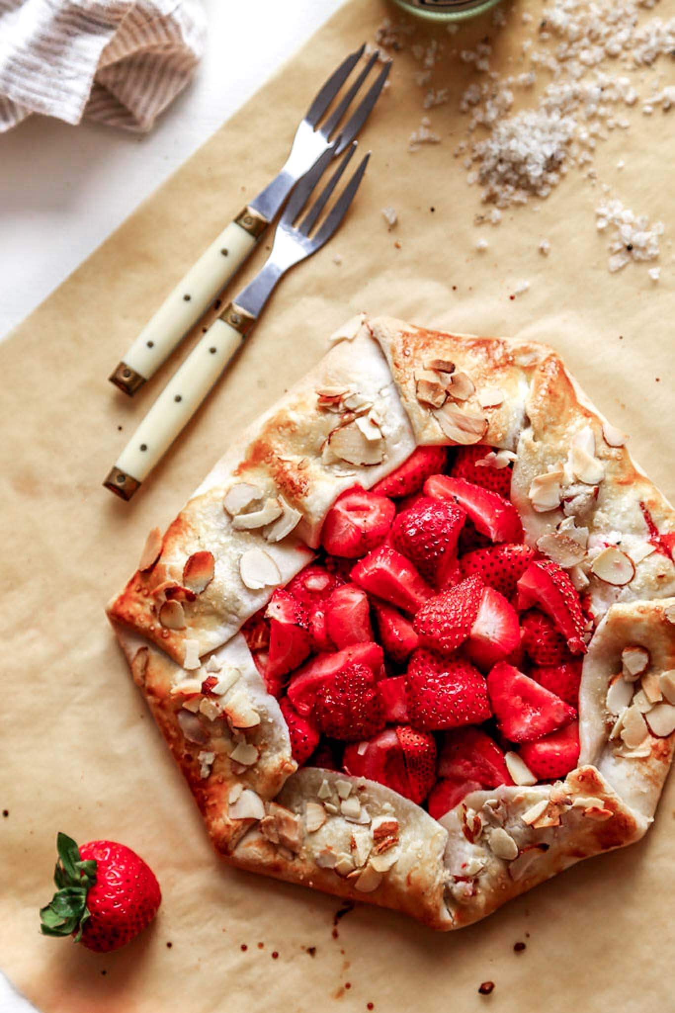 This rustic Strawberry Galette is a quick and easy dessert recipe that can be assembled in just 10 minutes using store-bought, refrigerated pie crust. | platingsandpairings.com