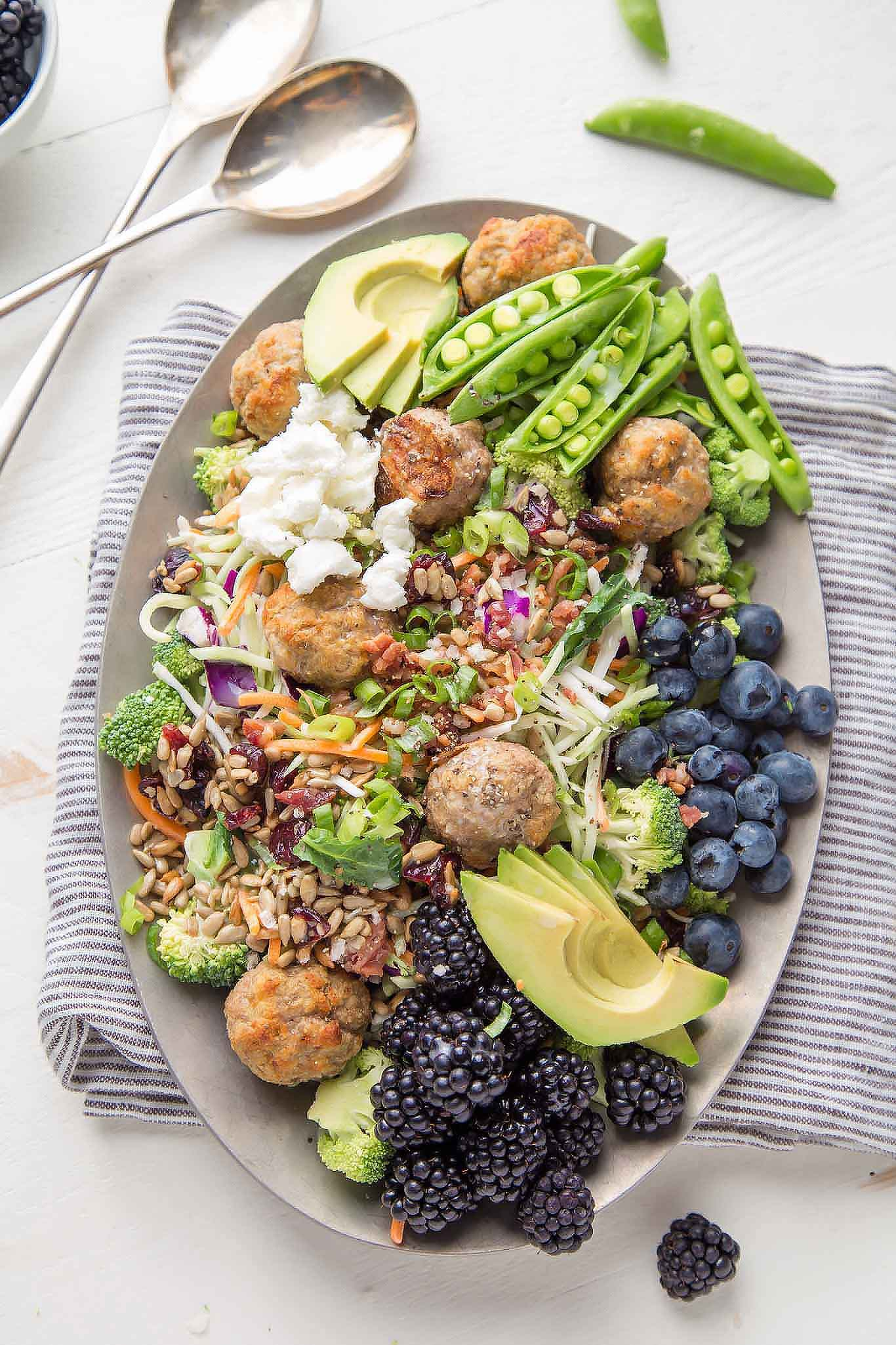 This Turkey Meatball Chopped Salad is loaded with veggies and topped with grilled fresh blackberries, blueberries, avocado and goat cheese. | platingsandpairings.com